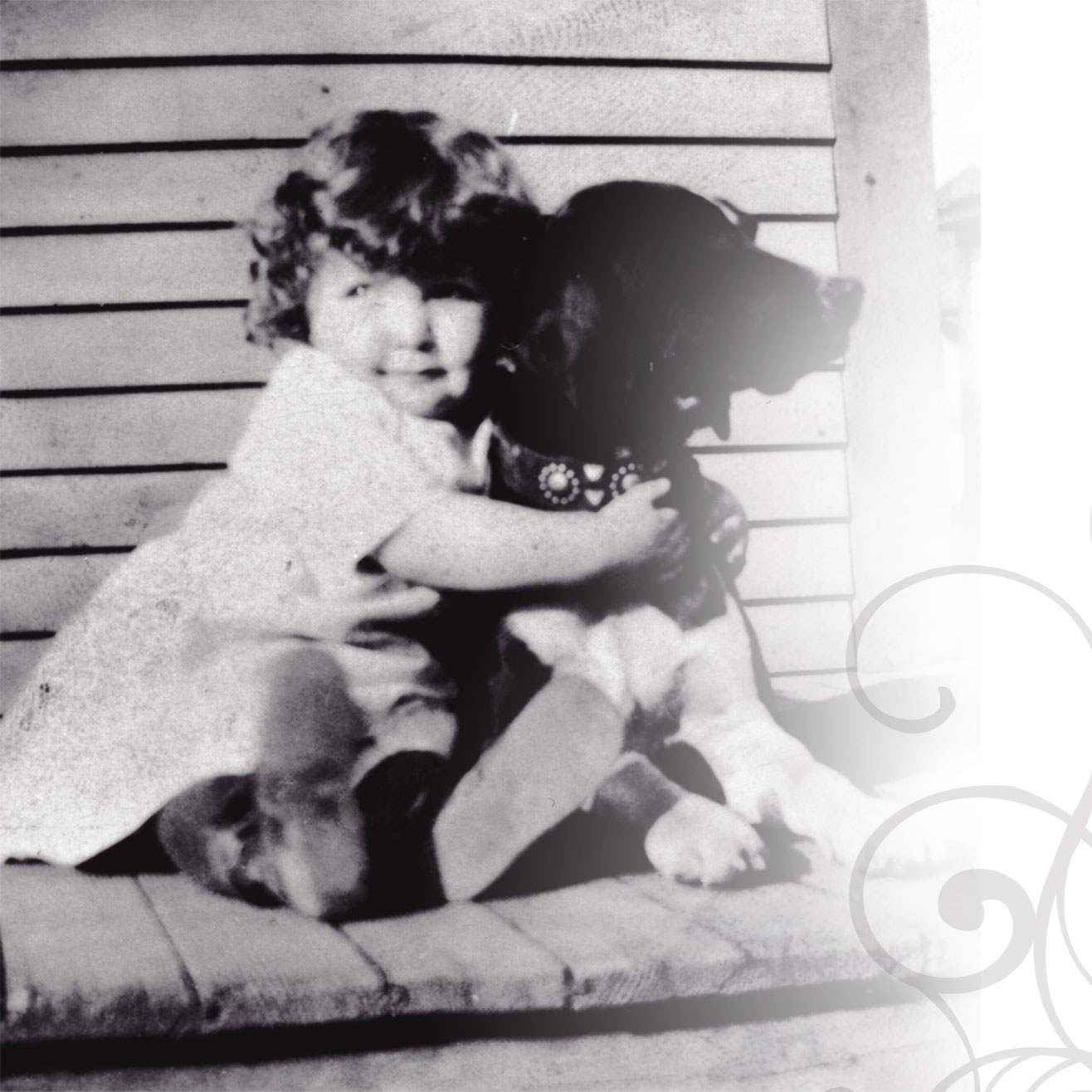 Child holding dog